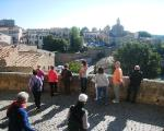 tourists in Tuscania enjoy a splendid panorama, including the City Hall (Comune)